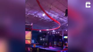 Prankster plays dead while going around zipwire