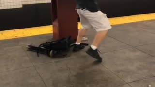 Guy white shorts black shirt karate kick subway pole