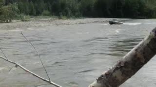 Boat Jumps River Blockage