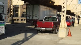 Semi Driver Tries to Pass Under Low Clearance Bridge, Fails