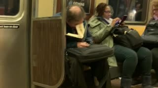 Old man asleep inside open book