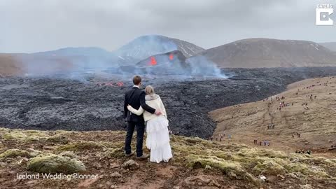 Couple Take Engagement Pictures In Front Of Active Volcano