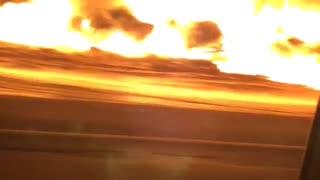 Train Derailment Fire Blazes in the Night