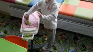 Little girl strokes linen