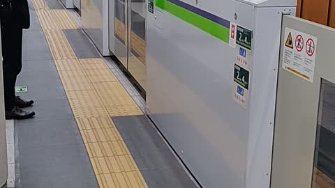 """Shinjuku Subway Line Train in Tokyo Pulling Into the Station with """"Train Coming"""" Flashing Light"""