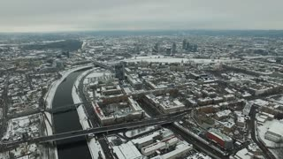 aerial view over the city near river winter 7