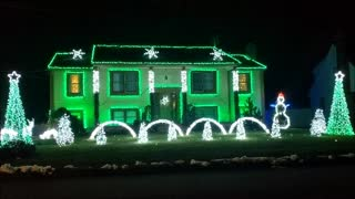 Festive decorations dazzle neighborhood with Christmas light display