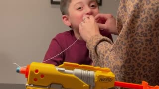 Parents use a Nerf gun to pull kid's tooth
