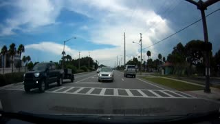 Completely clueless driver pulls into oncoming traffic