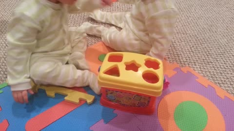 Check Out This Cute Baby Outsmarting His Twin Brother
