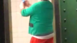 Man elf costume filming himself person sitting on floor