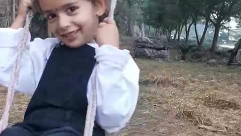 My little Manu in a Swing