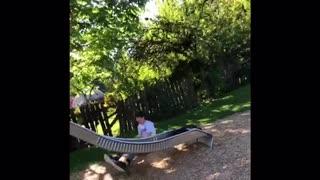 Guy in white shirt falls off silver slide