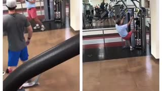 Man in pink shorts funny gym workout