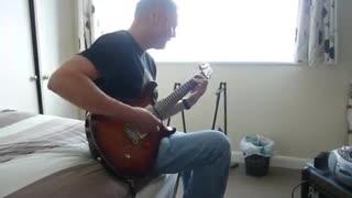 martin dennis playing guitar