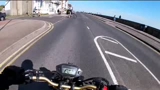 Cyclist Cuts into Road in Front of Motorcycle
