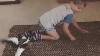 Baby Boy Plays With Birdy Catch The Socks