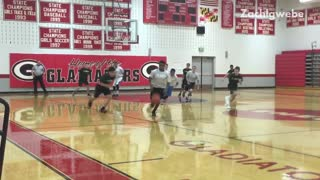 Student in grey shirt falls during basketball game