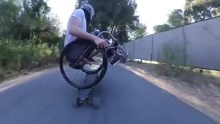 Downhill longboarding in a wheelchair