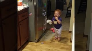 My troublemaker baby discovers the fridge