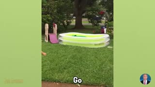 Funny babies playing at swimming pool