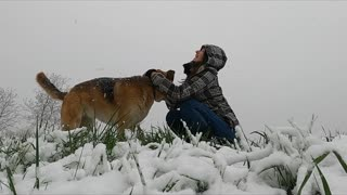 A Woman Playing With Her Dog !!