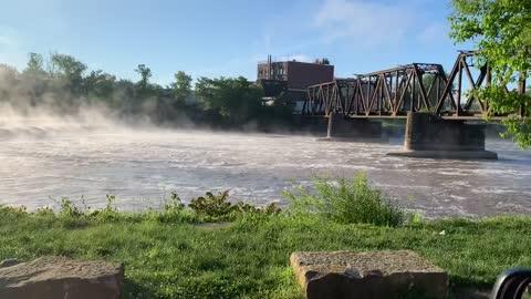 Roar of high water & mist over the dam