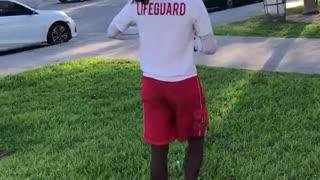 Guy white lifeguard shirt backflip on grass fail