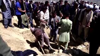 Victims buried as school blast death toll rises