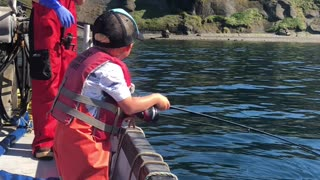Excited Three-Year-Old Catches a Fish
