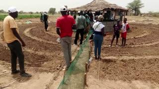 Senegal's circular gardens hold back the Sahara