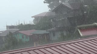 Heavy rain in a small town.