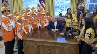 Little league championship team meets Trump