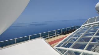 Standing on top a cruise ship