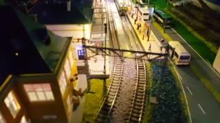 night scene of a model train layout