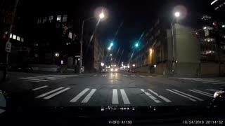 SUV driving down street wrong way