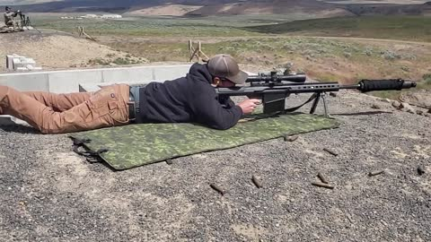 Shooting Suppressed Barret 50 cal.