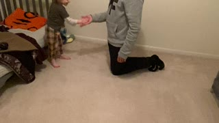 Son and daddy handshake