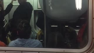 Outside of subway train person inside with giant white bowl