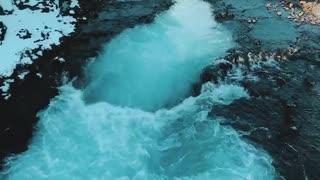 Beautiful Bruarfoss Waterfall Swirls with Glacial Waters