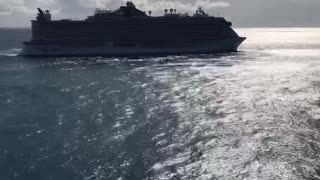 Giant Cruise Ship pulls out of a port TIME LAPSE