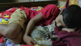Cute cat sleeping with owner