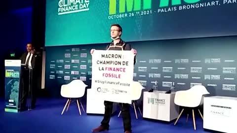 Activists disrupt green finance summit in Paris
