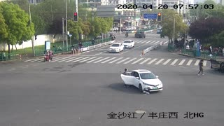 Woman Falls Out Of Car While Reversing At Crossroads