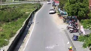 Man Fixing Hair On Scooter Crashes With GF Into Ditch