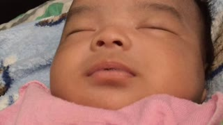 Baby smiling in his sleep