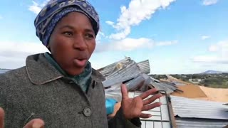 Ntombothanda Tyimbela trying to save what is left from her shack.