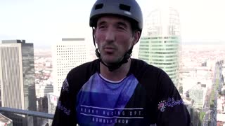 French athlete climbs 33-storey tower on his bike
