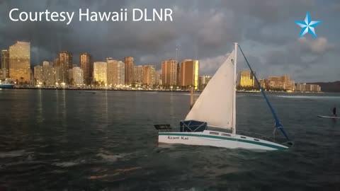 Sail boat grounded off Magic Island