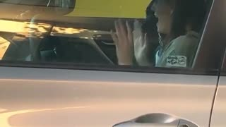 Woman Caught Excitedly Dancing in Car